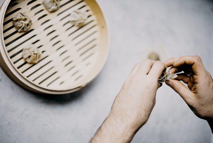 steaming dumplings in bamboo steamer